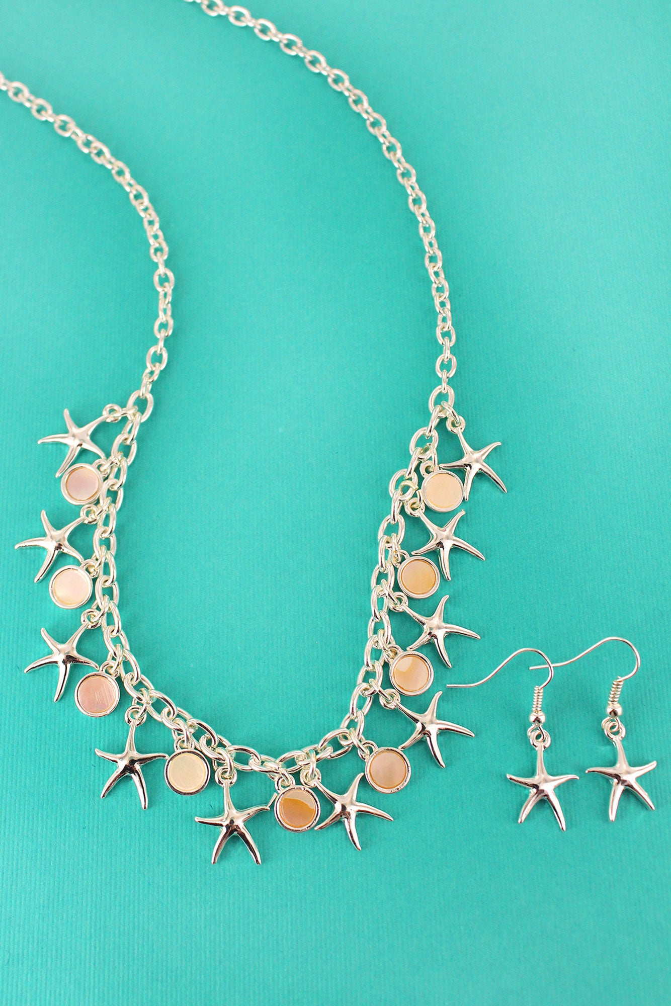 18f46cc037c4a Silvertone Starfish and Mother of Pearl Disk Charm Necklace and Earring Set