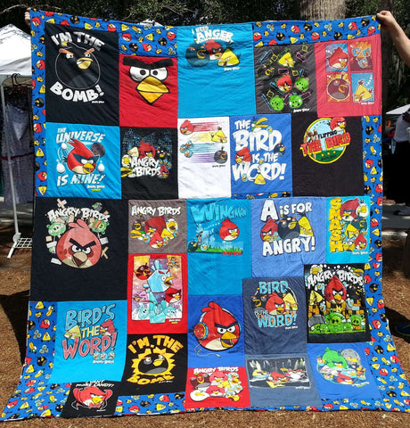 Angry Birds T-shirts upcycled into a full size quilt. T-shirt quilt made from Angry Birds fabric.