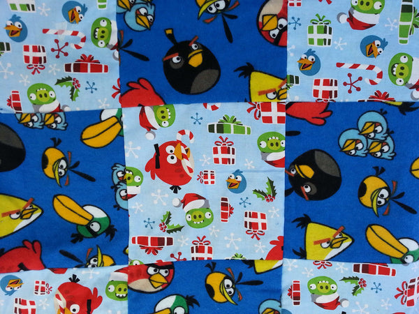 Angry Birds fabric made into a small Christmas blanket.