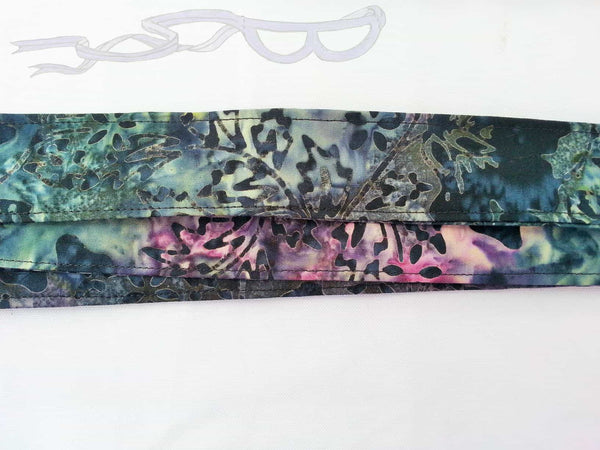 black batik fabric made into a yoga mat sling