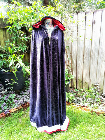 Black rose velvet hooded cloak. Lace trimmed black velvet cloak with shiny red lined hood.
