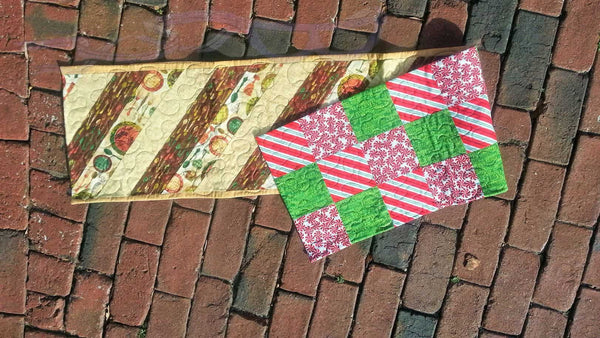 Quilted two sided holiday themed table runner.