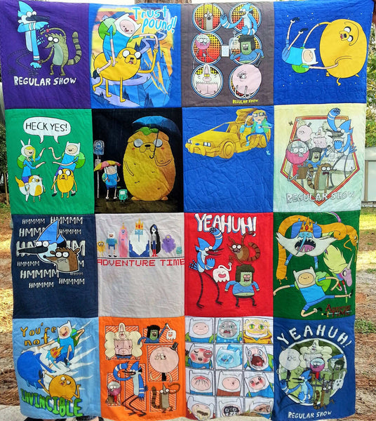 jake the human, finn the dog, bmo and more on a quilt made from Adventure time tshirts