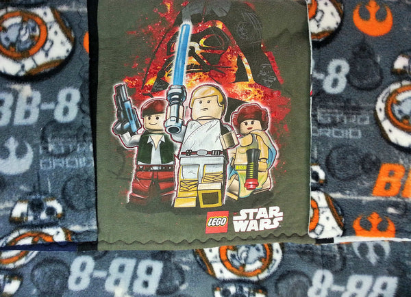 Lego Star Wars shirts made into a small quilt. Cotton quilt made from Lego Star Wars shirts and Star Wars BB8 fleece. Empire vs Rebels!