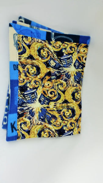 Blue police box fabric made into a small blanket, bow ties are cool
