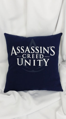 Assassin's Creed Unity tshirt made into a decorative pillow cover with the Assassin's Creed Unity logo in white on a navy background.