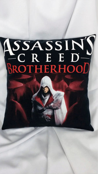 Assassin's Creed Brotherhood tshirt made into a decorative throw pillow with Ezio Auditore on a black background with the Assassin's Creed Brotherhood logo