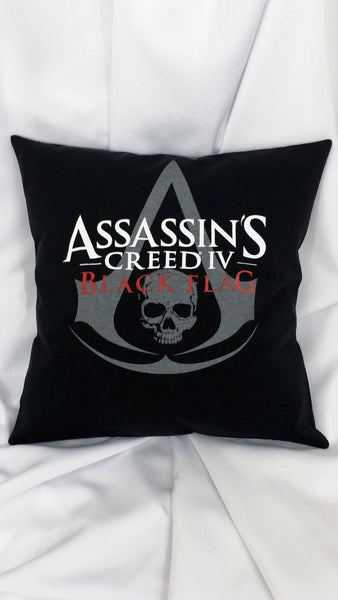 Assassin's Creed Black Flag tshirt made into a decorative throw pillow with the Assassin's Creed Black Flag logo on a black background.