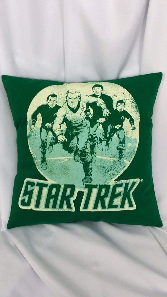 It has the classic Star Trek team in an action shot on a green background. James T. Kirk, Spock, Scott, Leonard McCoy