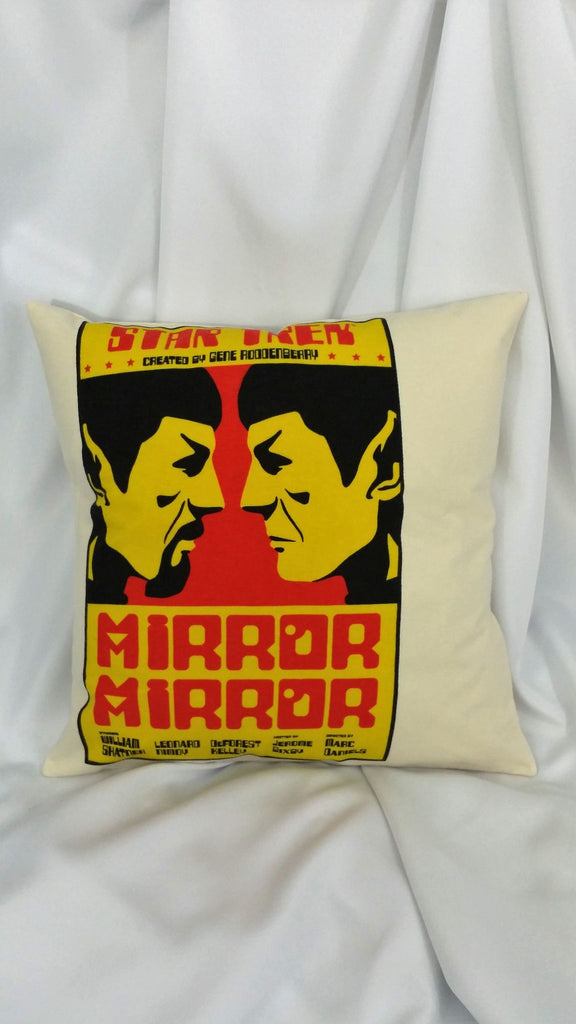 This asymmetrical throw pillow cover is made from a Star Trek tshirt. It features a left centered poster design for the episode Mirror Mirror from the original series and has Spock in a boxing style stance against his evil counterpart on a beige background.