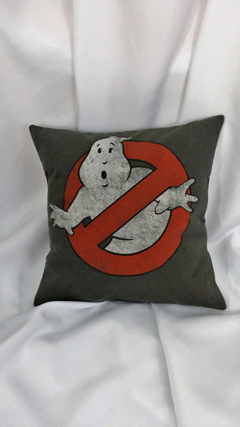 "his movie pillow cover is made from a distressed Ghostbusters tshirt. It features the No Ghosts logo of a red ""no"" circle over a white phantasm on a gray background."