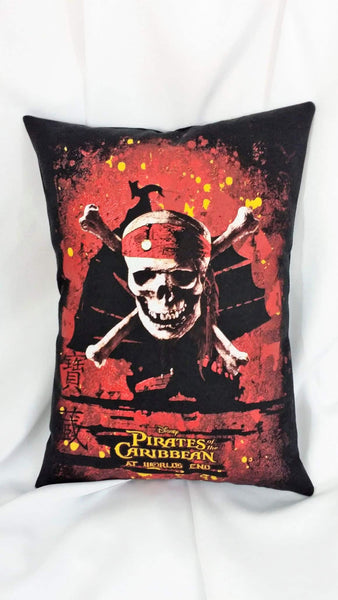 This movie pillow is made from a Pirates of the Caribbean At World's End movie tshirt. It features the skull and crossbones of Jack Sparrow in front of the silhouette of a Chinese treasure ship amidst a bloody landscape. The red is a thicker textured vinyl.