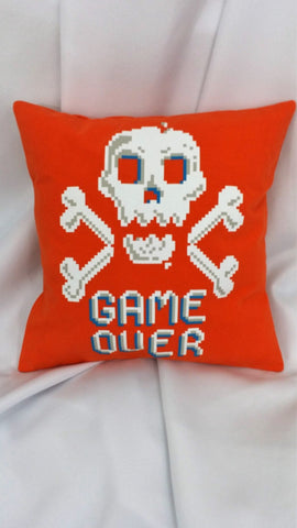 "This video game bedding has white skulls and crossbones over the words, ""Game Over"" on a bright orange background. Pair this with a ribbon and it will make a great ring bearer pillow."