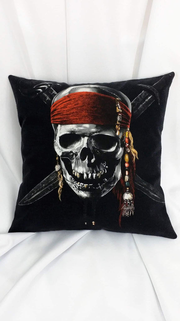 This movie decor is made from a Pirates of the Caribbean On Stranger Tides tshirt. It features the Stranger Tides skull movie poster design with Captain Jack Sparrows skull adorned with his signature red scarf over crossed swords on a black background.