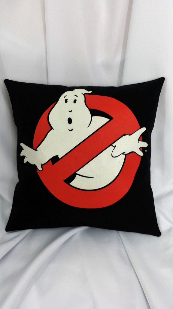 "This movie pillow cover is made from a Ghostbusters tshirt. It features the No Ghosts logo of a red ""no"" circle over a white phantasm on a black background"