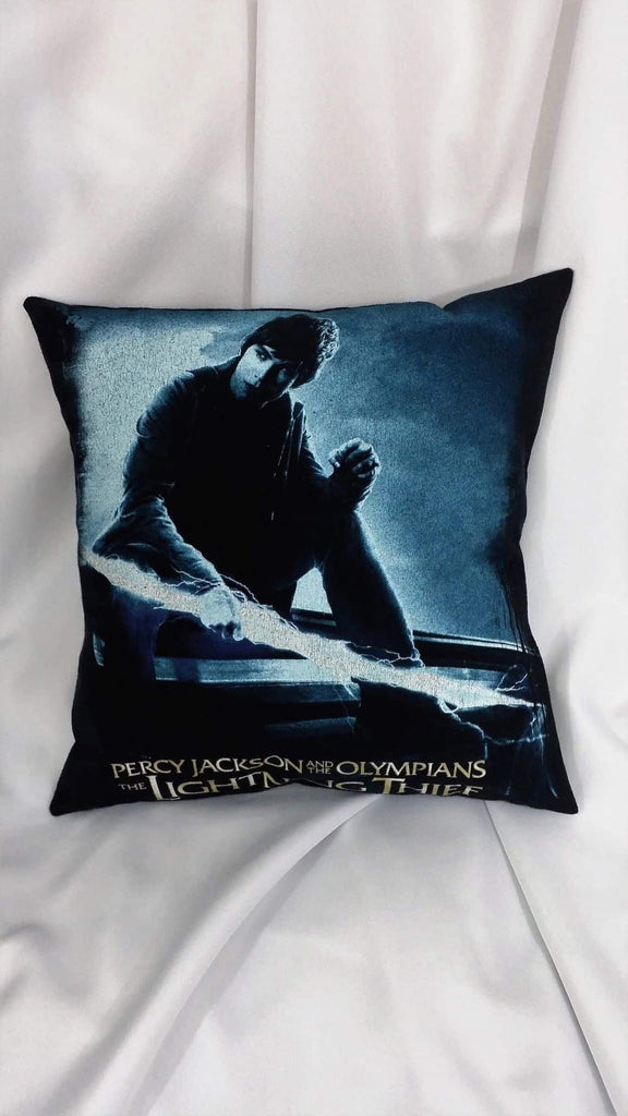 This movie decor is made from a Percy Jackson & The Olympians tshirt. It has Percy Jackson holding lightning with a blue filter on a black background over the logo for The Lightning Thief movie.