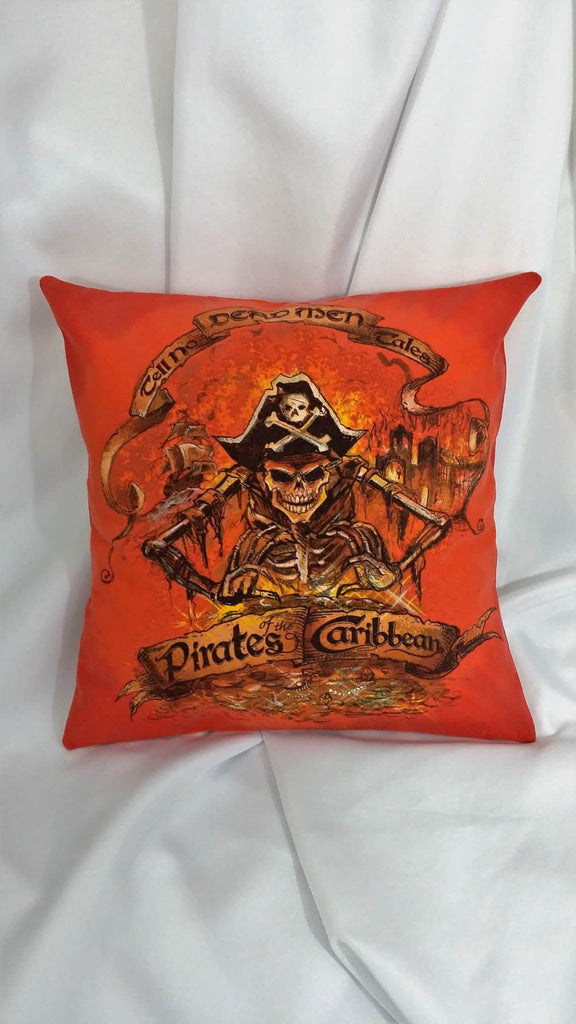 "This movie bedding is made from a Pirates of the Caribbean shirt. It features the old school skeleton with a pirate hat and the words, ""Dead Men Tell No Tales"" over the top on an orange background."