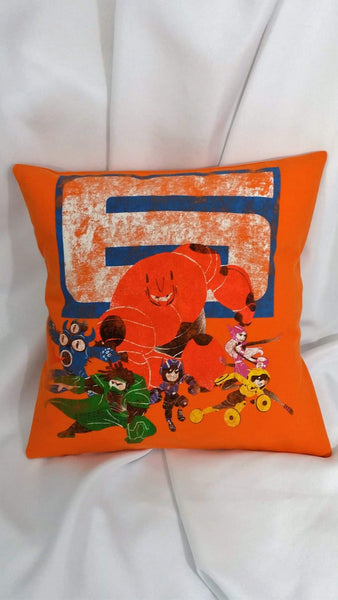 "This hero decor is made from a Big Hero 6 tshirt. It features a distressed design of the whole gang in their armor ready to go. It has Baymax, Go Go, Fred, Wasabi, Hiro, and Honey Lemon. in front of a giant ""6"" on an orange background."