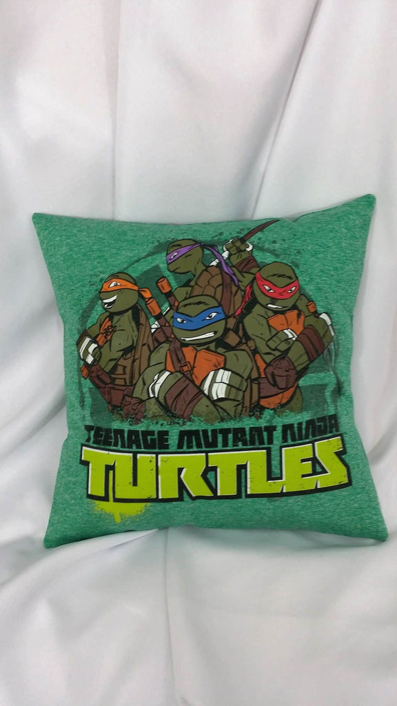 Teenage Mutant Ninja Turtles tshirt made into a decorative throw pillow cover with all 4 TMNT characters; Donatello, Raphael, Michaelango, and Leonardo