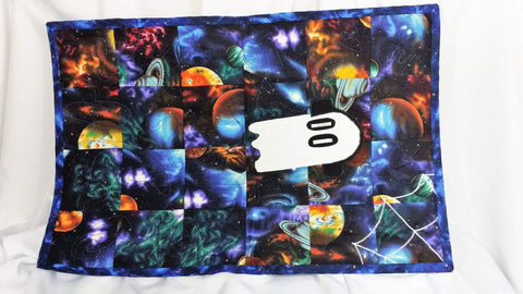 This quilted wall hanging is inspired by the wonderful video game Undertale. It features Napstablook in a sea of galaxies with a spiderweb in the corner. No Capes Store