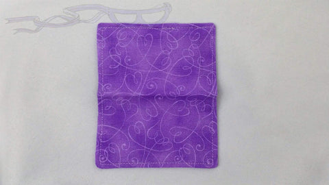 "It features purple hearts and swirls on a purple background. It is handmade measuring 4"" x 5"" open and 4"" x 2.5"" closed."