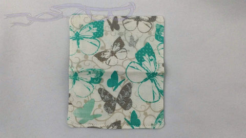 "It features blue and silver butterflies on a white background. It is handmade measuring 4"" x 5"" open and 4"" x 2.5"" closed."