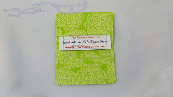 "It features a repeating lime green flowered design. It is handmade measuring 4"" x 5"" open and 4"" x 2.5"" closed."