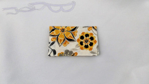 This card holder is an inspirational gift for any new graduate entering the world. It features yellow and black flowers on a white background.