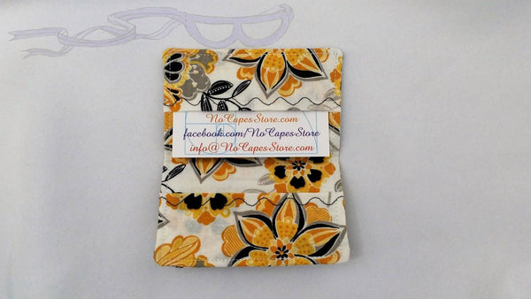 "It is handmade measuring 4"" x 5"" open and 4"" x 2.5"" closed. Also makes for a great gift card holder or stocking stuffer."
