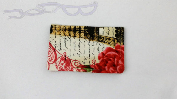"It features french writing over the Eiffel Tower, bordered by pink scroll and roses on a white background. It is handmade measuring 4"" x 5"" open and 4"" x 2.5"" closed."