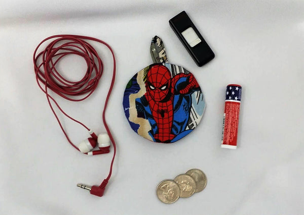 This ear bud pouch is made from Marvel fabric. It features Spider-man. Can also be used for USB, flash drives, lip balm, and more.