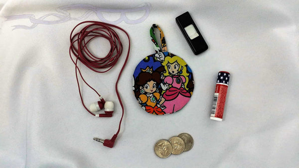 Ear bud holder made with Daisy and Peach fabric. Nintendo cotton made into an ear bud pocket, lip balm case, usb holder, ear bud pouch.