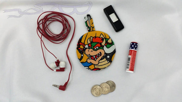 This ear bud pouch is made from Nintendo Super Mario fabric. It features the fear-inspiring turtle, Bowser, front and center on it