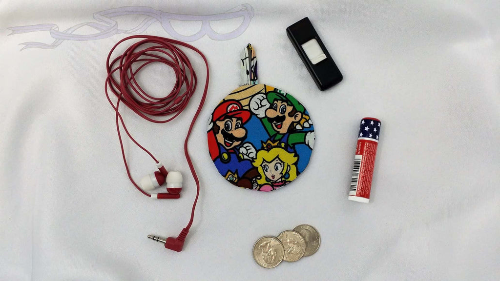 Ear bud holder made with Super Mario and Luigi fabric. Nintendo cotton made into an ear bud pocket, lip balm case, usb holder, ear bud pouch.