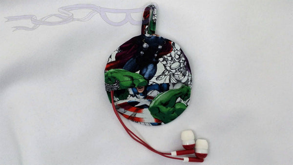 This ear bud pouch is made from Marvel Avengers fabric. It features Thor as a character sketch with Iron Man's pulse hand.