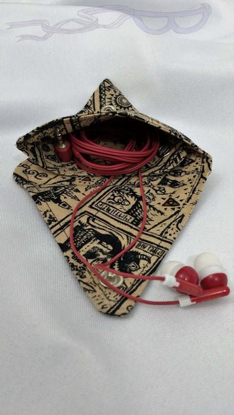 This snap pouch is made from Wind Waker scrolls fabric. It tells the story of Link and the Triforce in pictographs.