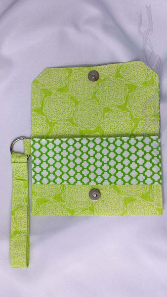 These green patterns are crazily mixed. This funky wristlet is made with green cotton patterned fabrics and has a neon zipper. What? Yes, a florescent green zipper on the back.