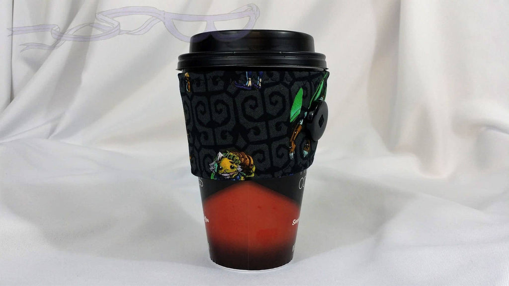 Hot Coffee Sleeve made with Majora's Mask Link fabric. Hot Coffee Jacket, Coffee Cozy, Coffee Sleeve, Reusable Coffee Jacket, Java Jacket, Coffee Lover Gift