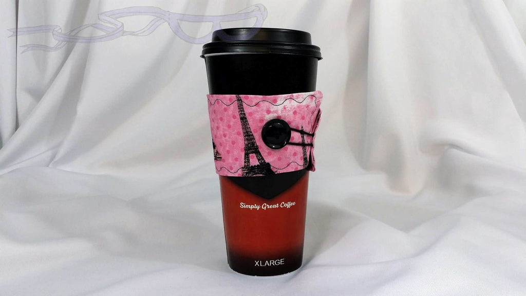 It has the Eiffel Tower in black on a bright pink background. It is made with cotton fabric on both sides and the inside has soft cotton for insulation.