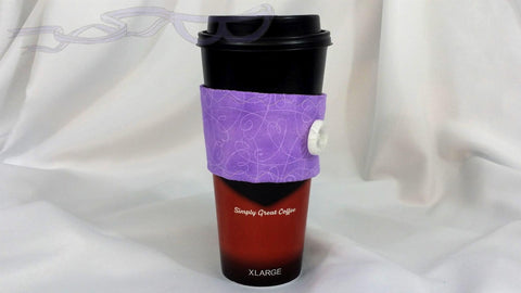 It has light purple hearts and swirls on a darker purple background. It is made with cotton fabric on both sides and the inside has soft cotton for insulation.