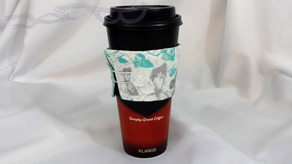The closure is an elastic loop that goes around the button. This makes it adjustable to fit most sizes of cups and mugs.
