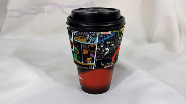 This coffee sleeve is made from Star Wars fabric. The design has the old school characters on comic book covers.