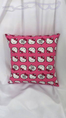 It features Kitty with several cute faces and her bow on a dark pink and white dotted background.