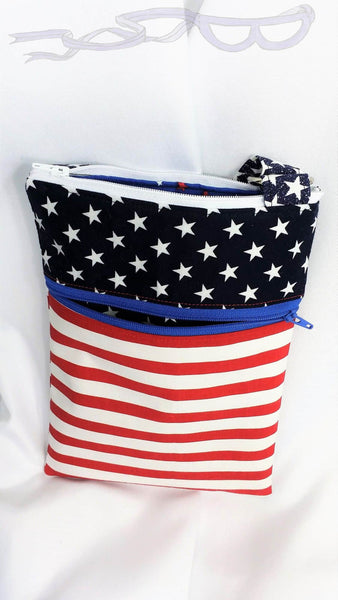"This patriotic bag is approximately 10"" x 7"" (25 cm x 18 cm). One side has an open pocket with decorative stitching and the other side has a zipper closure."