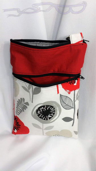 The pockets feature red, black, and gray flowers on a white background. The top accents are a solid red premium cotton fabric.