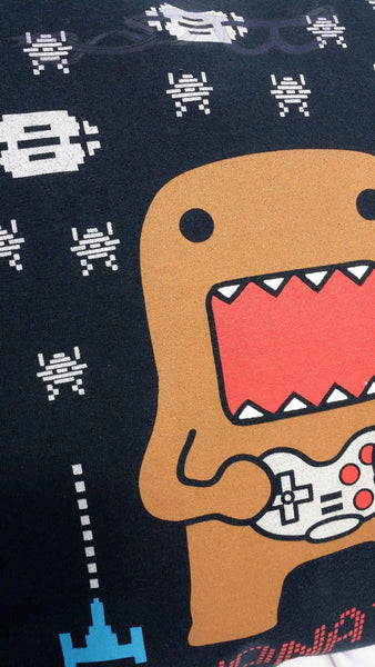 It depicts Domo with a controller shooting down aliens and space ships on a navy background.