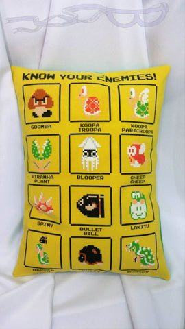 "Goomba, Koopa Troopa, Paratroopa, Piranha Plant, Blooper, Cheep Cheep, Spiny, Bullet Bill, Lakitu, Hammer Bro, Buzzy and Bowser can be in your bedroom! This video game bedding is made from a Nintendo Super Mario Bros t shirt. It features all those characters labeled under the words, ""Know your enemies"" on a yellow background."