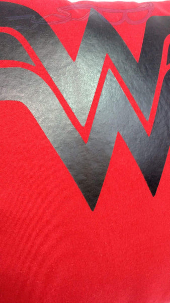 It features the Wonder Woman logo in black vinyl on a red background. Makes for a great gift to any comic book or movie fan.