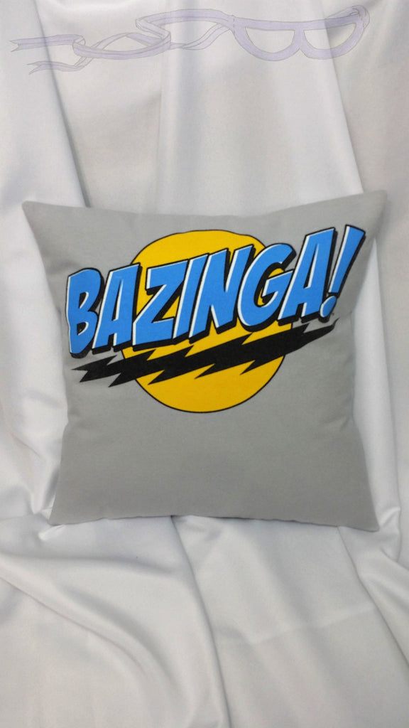 "A decorative throw pillow made from a geeky cotton TV show shirt with Sheldon Coopers' famous ""Bazinga"" line in blue."
