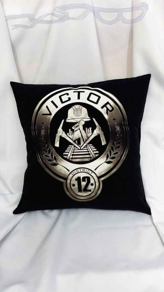 Heroine bedding made from The Hunger Games District 12 shirt. Coal miners district tshirt made into a throw pillow cover.